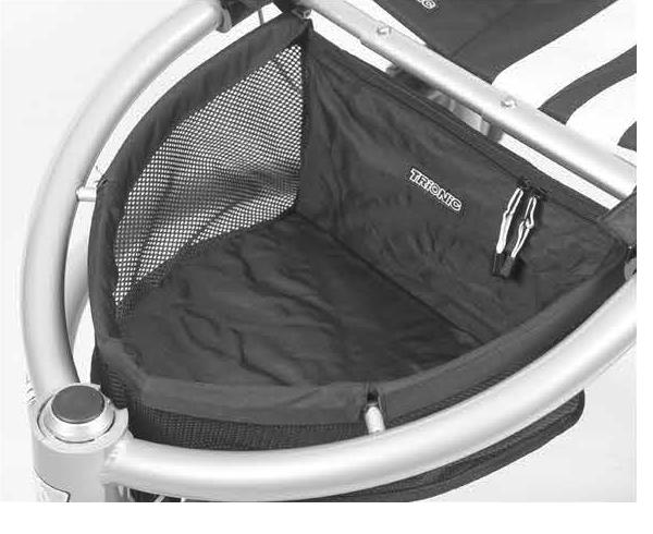 1. Оберните задние клапаны на липучке вокруг реек снизу, между рамой и рейкой корзины. Сложите их внутрь и зафиксируйте липучки на внутренней стороне подкладки корзины.